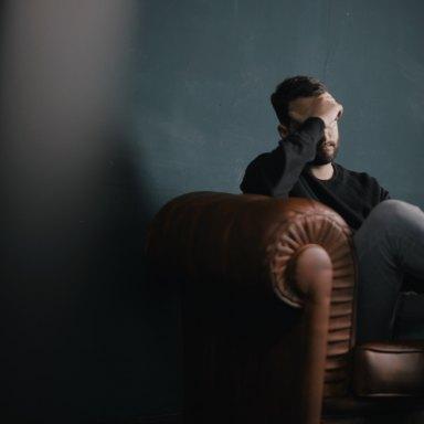 man sitting looking depressed