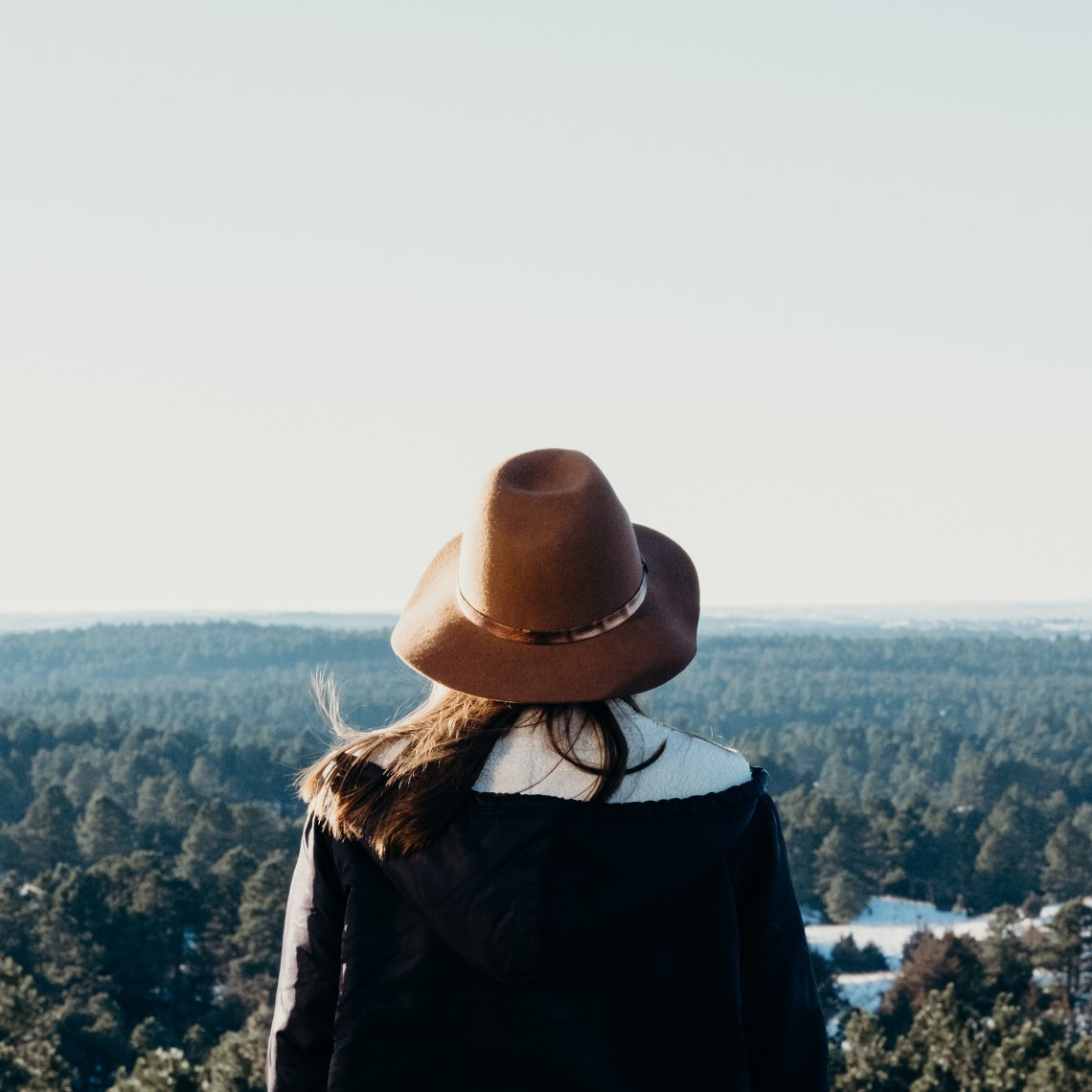 woman facing valley