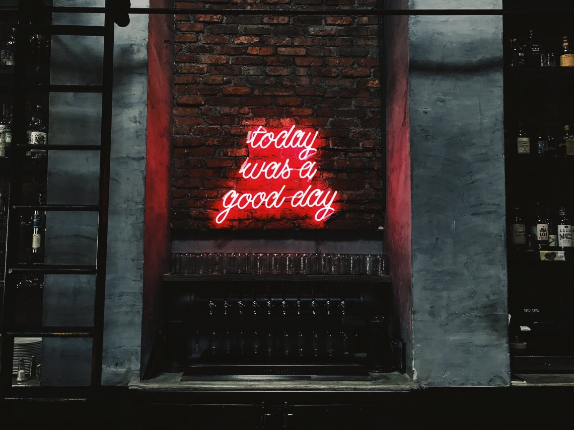 brick wall with neon sign