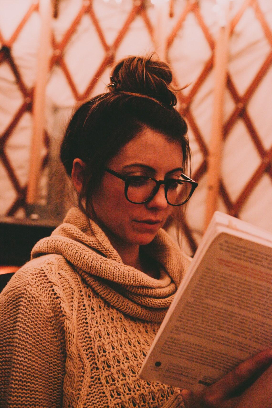 girl in glasses reading