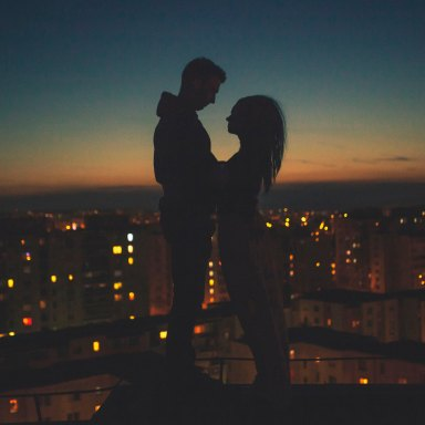 couple with cityscape in background