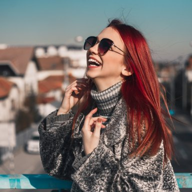 girl laughing in sunglasses