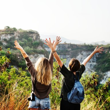 girls with their arms outstretched