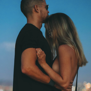 Couple standing over city skyline