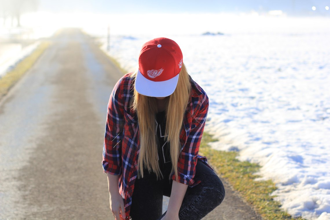 woman wearing hat looking down