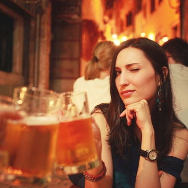 woman cheersing with beer