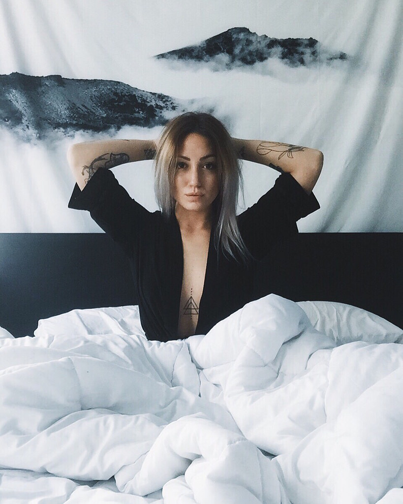girl in bed with tattoos