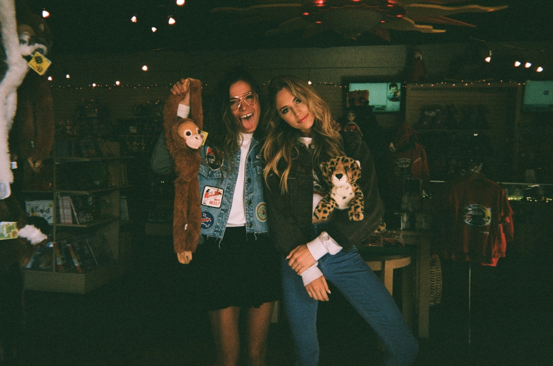 friends posing together in zoo giftshop