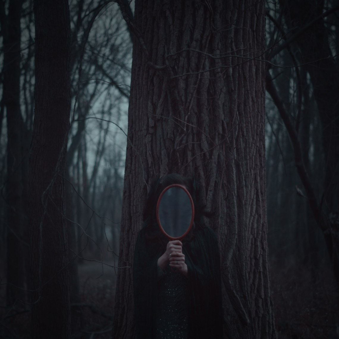 creepy woman with a mirror