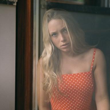 woman looking sad in polka dot dress