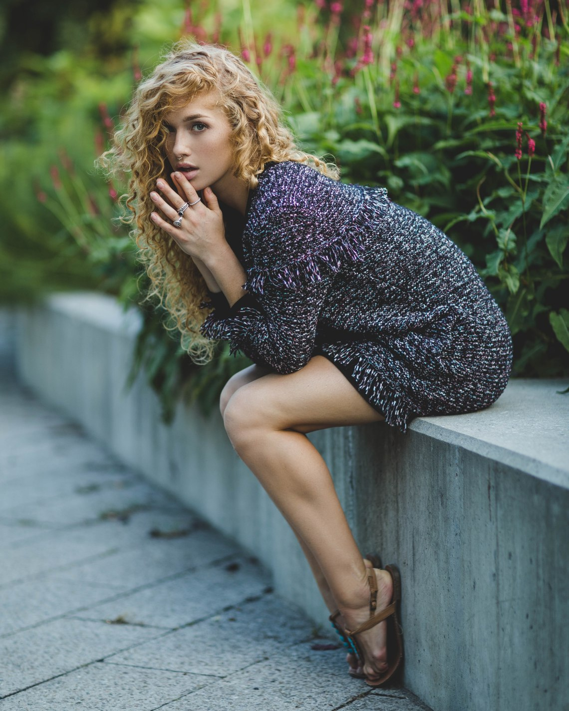 woman sitting on ledge