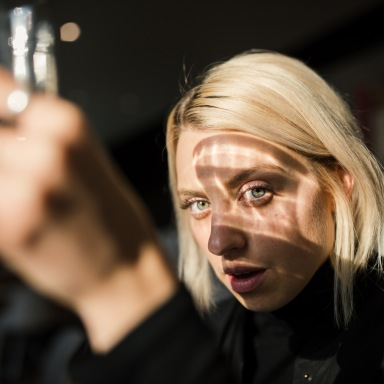 girl looking through a reflective glass