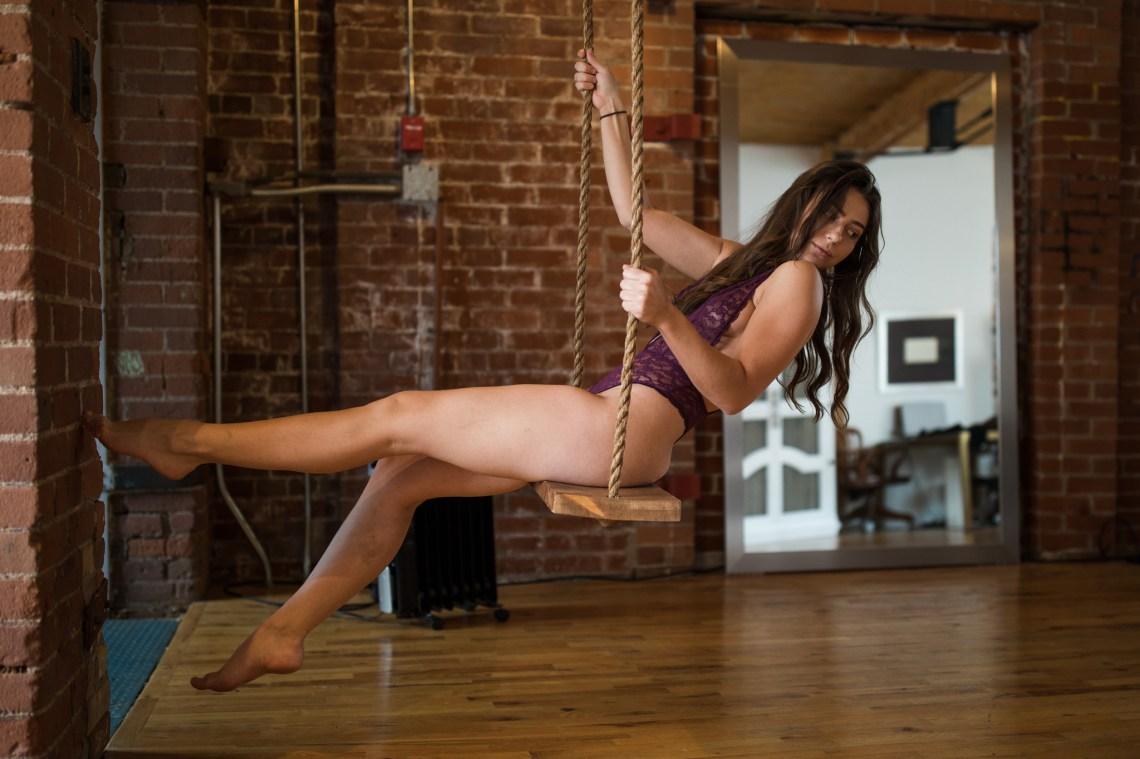 girl in lingerie on a swing