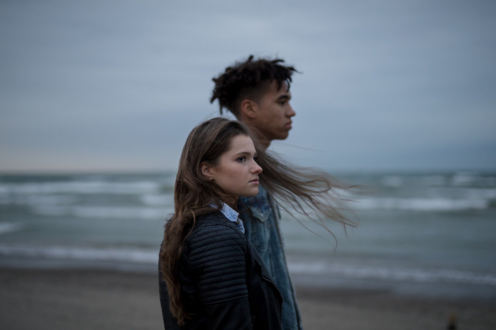 moody couple on the beach