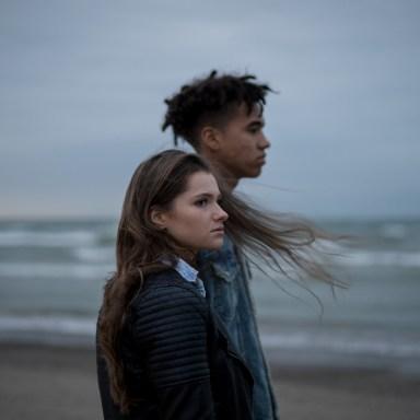 moody couple on the beach