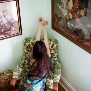 woman sitting on floral chair