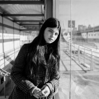 woman standing on subway ledge