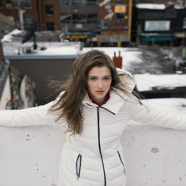 distressed looking girl in white winter coat
