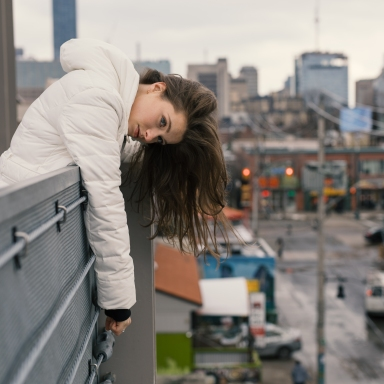 woman leaning over edge