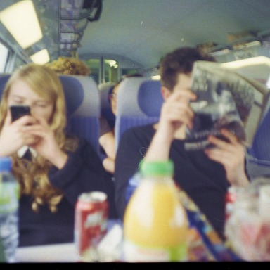 guy and girl on a bus with a lot of snacks