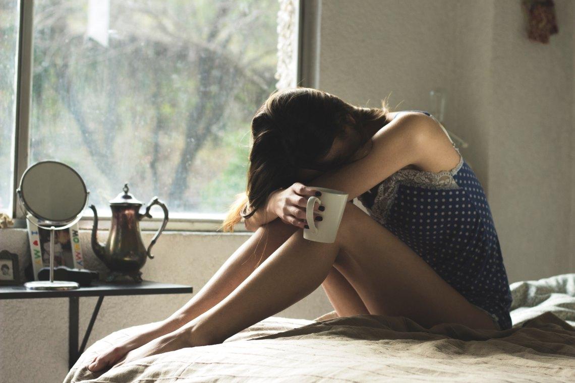 girl tea sad bed