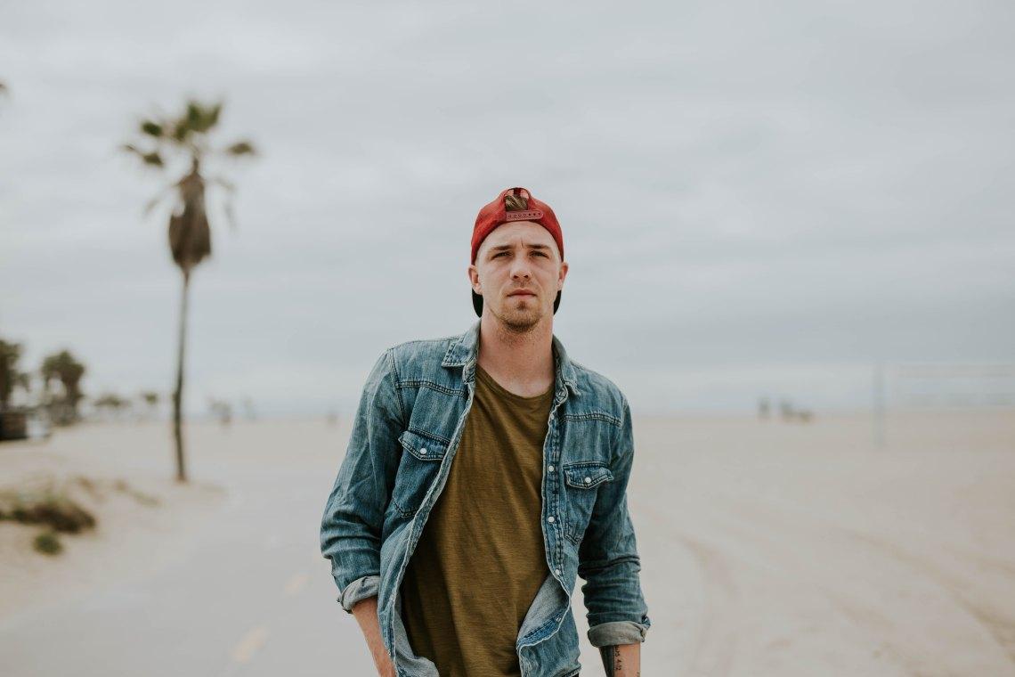 guy walking on beach