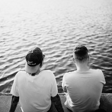 two men by a body of water
