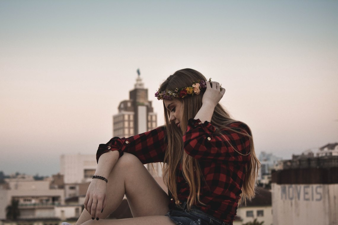 woman sitting with flower crown