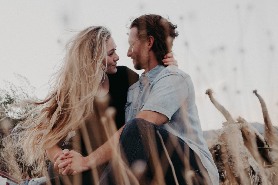couple embracing in field