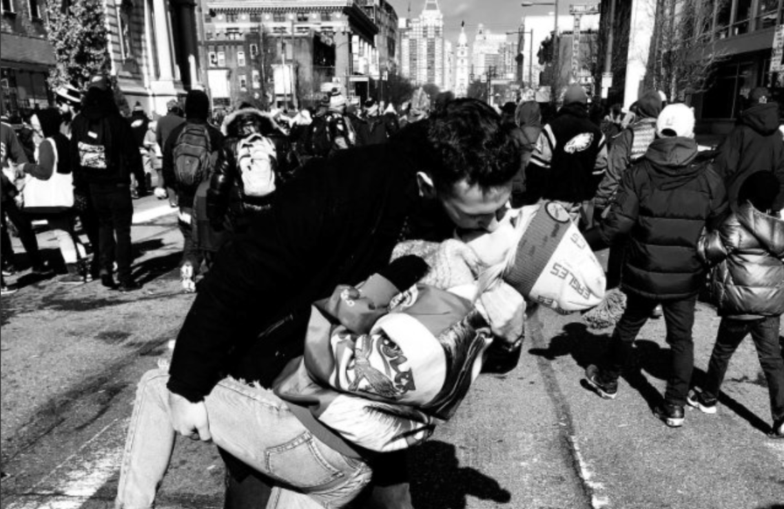 Two Eagles fans kissing in the street during the SUper Bowl parade