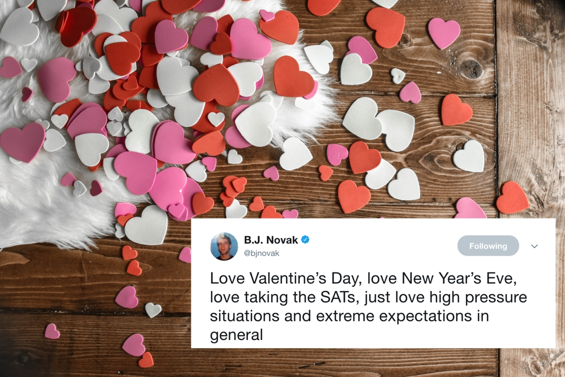 A table full of paper hearts and a tweet from BJ Novak about Valentine's Day
