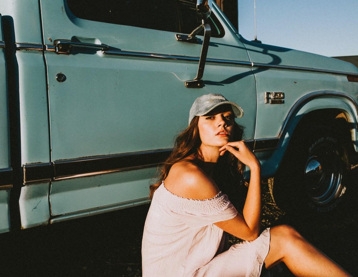 woman baseball cap truck