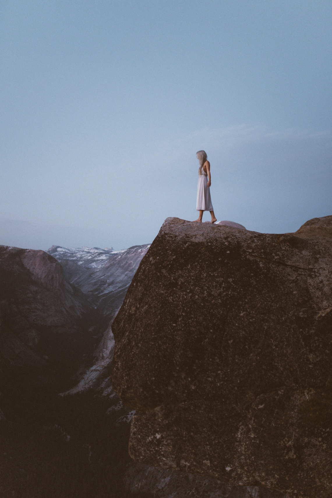 girl in white standing on the mountains