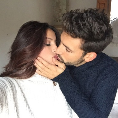 couple taking a selfie while kissing