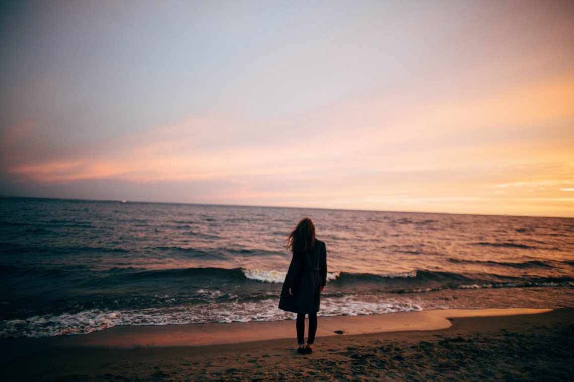 girl standing by the coast