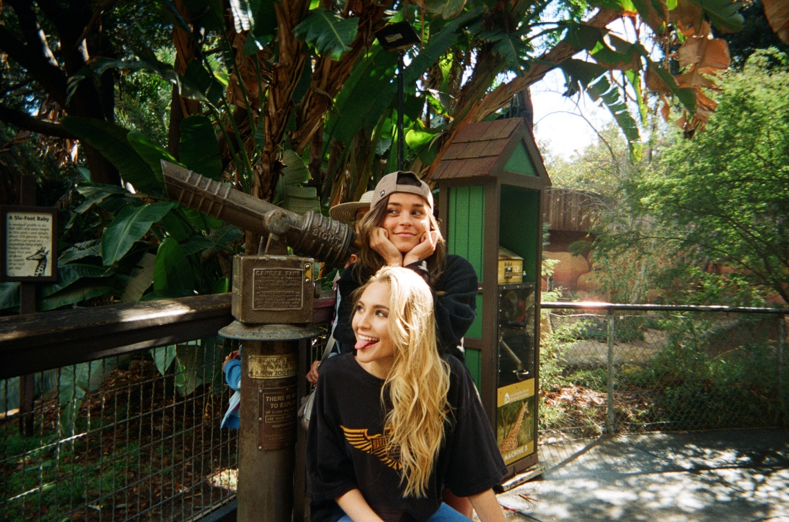 friends goofing around at zoo