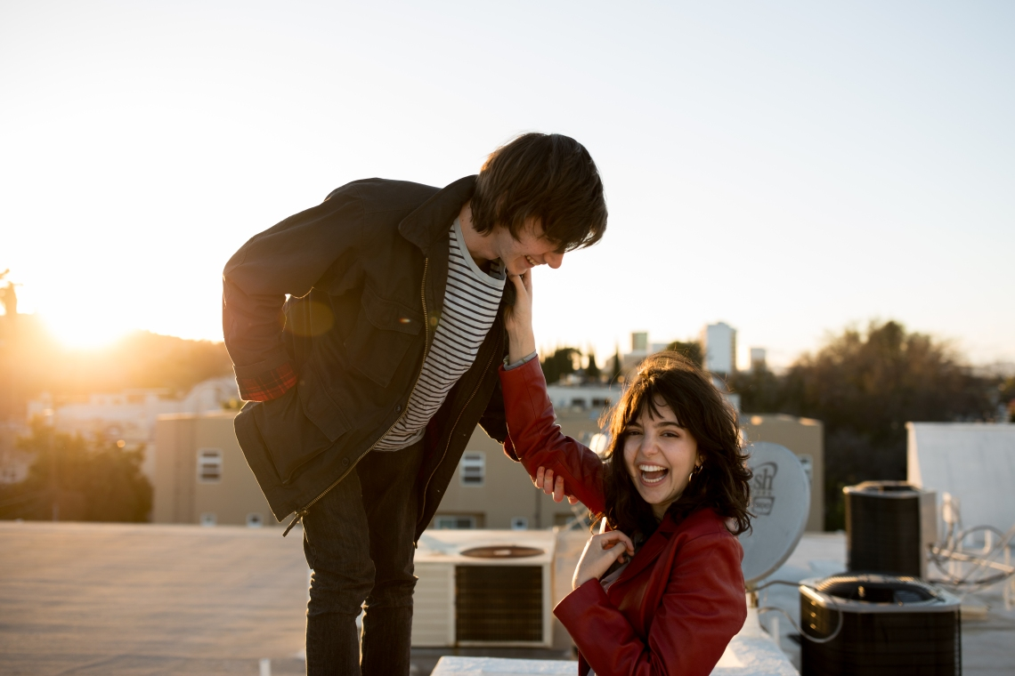 couple looking happy together on rooftop