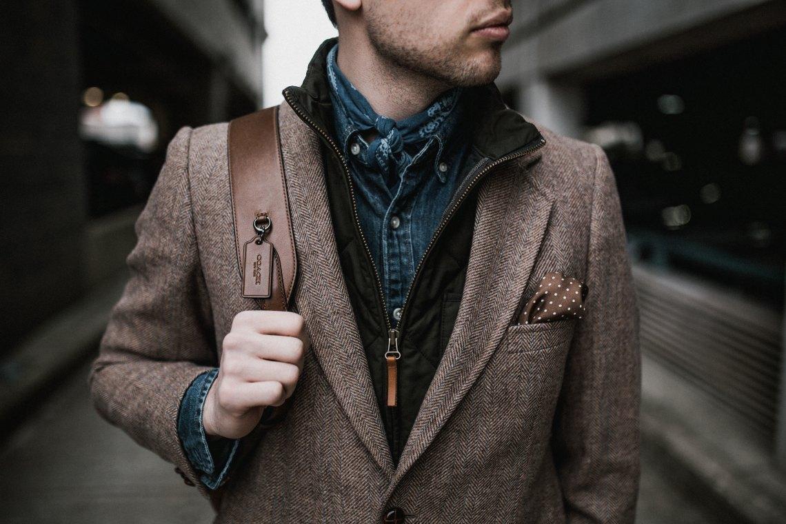 man in blazer and walking