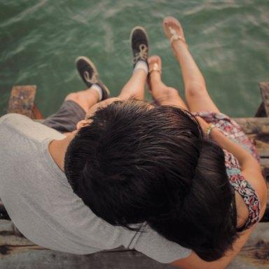 couple cuddling on dock