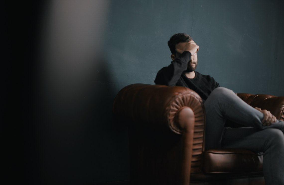 sad guy sitting on couch
