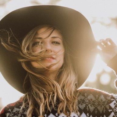 wind hair sunlight hat