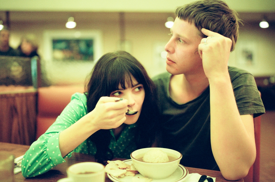 couple sharing meal at diner