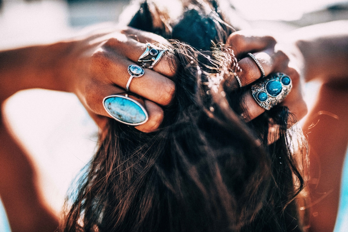 woman wearing turquoise rings