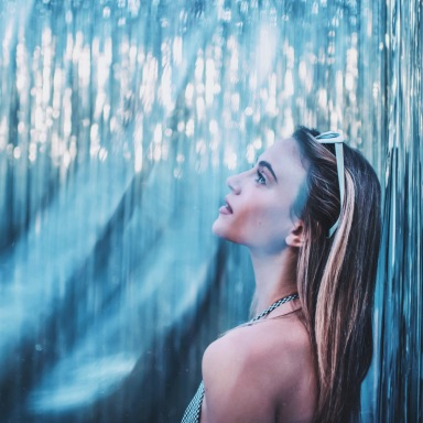 woman standing in blue and glittering room
