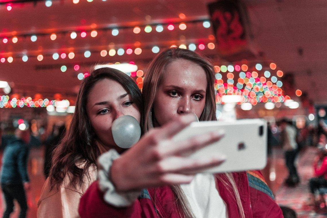Friends taking selfies