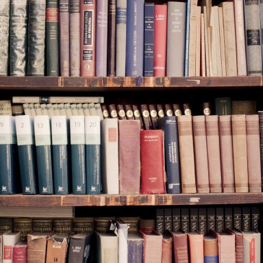 Old books lined on a bookshelf