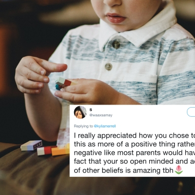 A little kid playing with legos and a tweet about acceptance