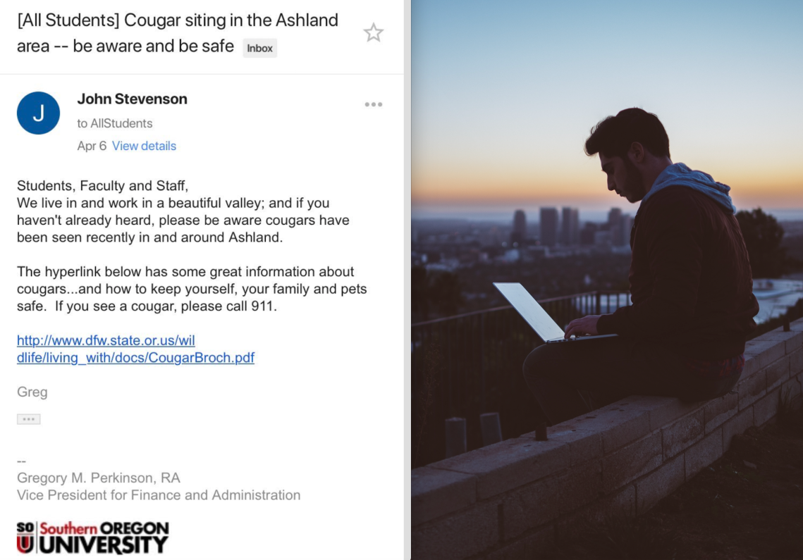 A university email and a man sitting on a ledge with a laptop