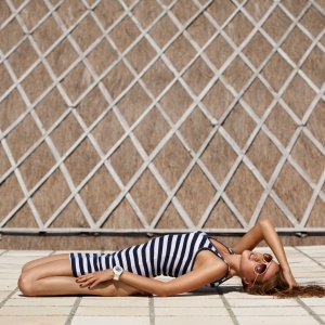 woman laying on deck