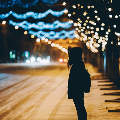 woman standing alone on cold night